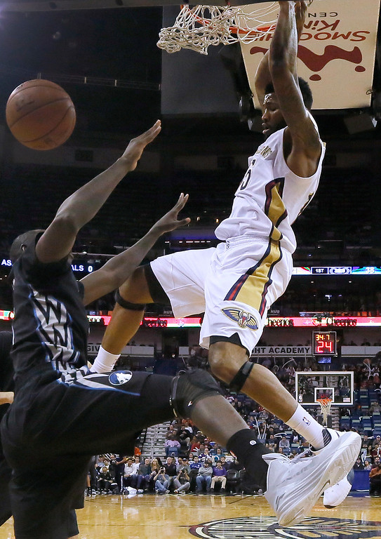 . New Orleans Pelicans forward Alonzo Gee, right, dunks over Minnesota Timberwolves center Gorgui Dieng during the first half of an NBA basketball game Tuesday, Jan. 19, 2016, in New Orleans. (AP Photo/Jonathan Bachman)