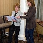 Vicki Buster and Leslie Taylor examine the grant candidates.