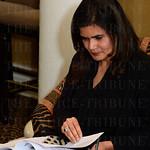 Ritu Furlan reads the grant options.