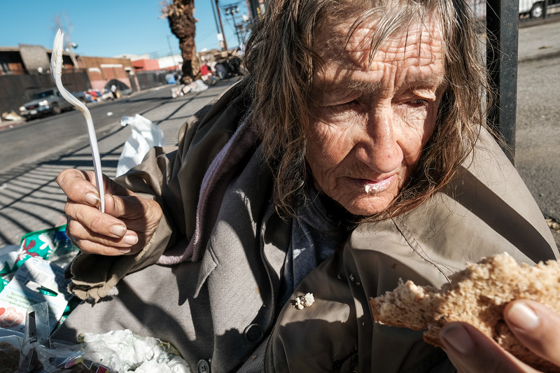 Leanne having breakfast on the street at 7th and Stanford Ave, Skid Row, Los Angeles