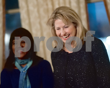 Ruth Flynn laughs as she introduces herself during a reception at the McClendon House. Flynn is one of six women who will behonored at the 2015 Women in Tyler luncheon in March. (Victor Texcucano/Staff)