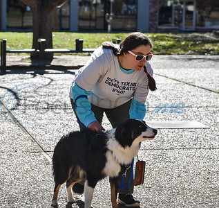 """Melissa Al-Ahmadi attends the Tyler Women's March with her dog Smalls wearing a """"We are Texas Democrats Y'all"""" t-shirt. The event was held on January 19 and welcomed children and pets to participate. (Jessica T. Payne/Tyler Morning Telegraph)"""