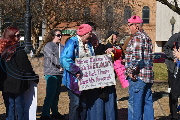 Protesters gathered with signs and microphones at the Downtown Square in Tyler. Tyler's inaugural Women's March was held on Sunday, January 19 and was hosted by the Democratic Club of Smith County. (Jessica T. Payne/Tyler Morning Telegraph)