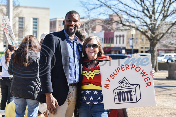 Pastor John Walton (left) who is running for Smith County Democratic Chair smiles for a photo with Charleen Worsham dressed as Wonder Woman. Worsham drove from Longview to attend the even which was held on Sunday, January 19 in downtown Tyler. (Jessica T. Payne/Tyler Morning Telegraph)