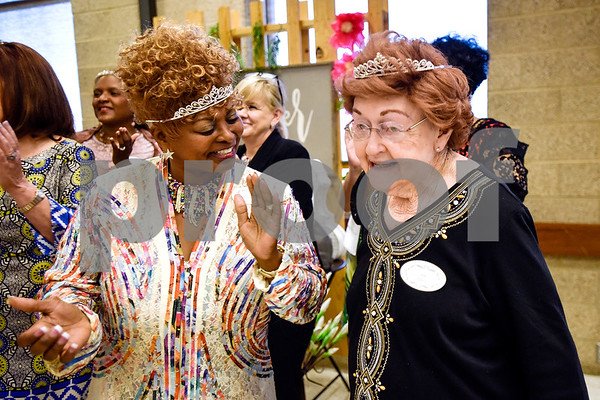 """Committee members Debra Christian and June Elliott dance to """"We Are Family"""" during the Women in Tyler Luncheon at the Tyler Rose Garden Center in Tyler, Texas, on Thursday, March 23, 2017. The Women in Tyler Planning Committee honored six women who have made an impact in the community. (Chelsea Purgahn/Tyler Morning Telegraph)"""
