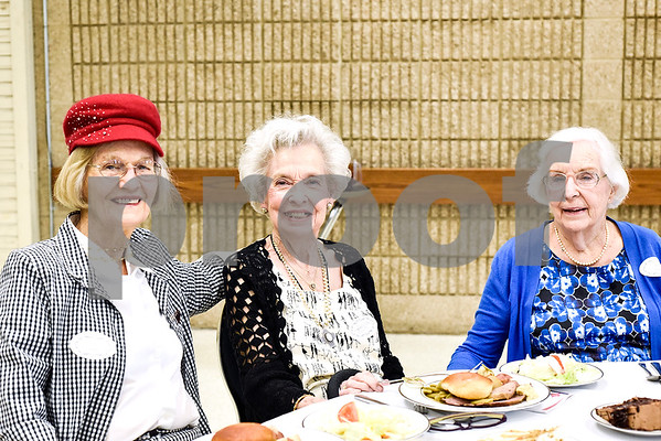 Lois Pattillo, Yvonne Collett and Mary Hudson pose for a photo during the Women in Tyler Luncheon at the Tyler Rose Garden Center in Tyler, Texas, on Thursday, March 23, 2017. The Women in Tyler Planning Committee honored six women who have made an impact in the community. (Chelsea Purgahn/Tyler Morning Telegraph)