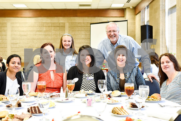 From left to right, Tharani Devi, Kristi Boyett, Isabelle Heines, 11, Amber Rojas, Martin Heines, Jennifer Pittman and Lisa Crossman pose for a photo during the Women in Tyler Luncheon at the Tyler Rose Garden Center in Tyler, Texas, on Thursday, March 23, 2017. The Women in Tyler Planning Committee honored six women who have made an impact in the community. (Chelsea Purgahn/Tyler Morning Telegraph)