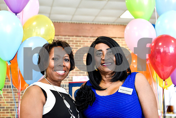 Tamma Isabell and Brinda Simmons pose for a photo during the Women in Tyler Luncheon at the Tyler Rose Garden Center in Tyler, Texas, on Thursday, March 23, 2017. The Women in Tyler Planning Committee honored six women who have made an impact in the community. (Chelsea Purgahn/Tyler Morning Telegraph)
