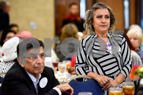 Susana Castro stands as she is honored during the Women in Tyler Luncheon at the Tyler Rose Garden Center in Tyler, Texas, on Thursday, March 23, 2017. The Women in Tyler Planning Committee honored six women who have made an impact in the community. (Chelsea Purgahn/Tyler Morning Telegraph)
