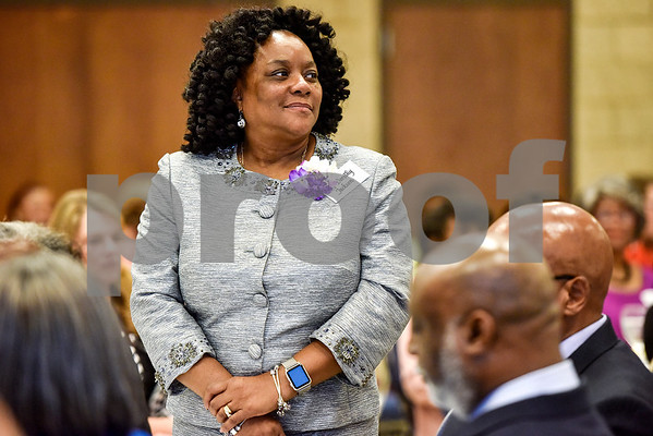 Dorothy Jackson stands as she is honored during the Women in Tyler Luncheon at the Tyler Rose Garden Center in Tyler, Texas, on Thursday, March 23, 2017. The Women in Tyler Planning Committee honored six women who have made an impact in the community. (Chelsea Purgahn/Tyler Morning Telegraph)