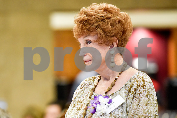 Misti Ford stands as she is honored during the Women in Tyler Luncheon at the Tyler Rose Garden Center in Tyler, Texas, on Thursday, March 23, 2017. The Women in Tyler Planning Committee honored six women who have made an impact in the community. (Chelsea Purgahn/Tyler Morning Telegraph)