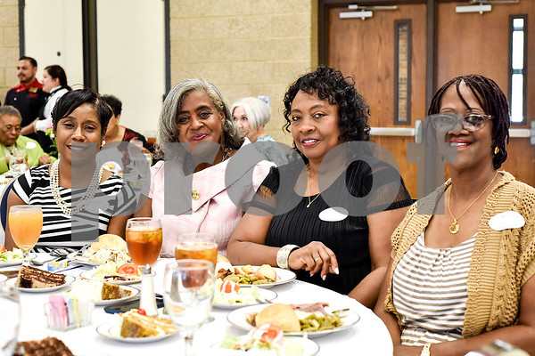 Tricia Billington, Charlotte Graves, Lamisa Landers and Deria Blacksher pose for a photo during the Women in Tyler Luncheon at the Tyler Rose Garden Center in Tyler, Texas, on Thursday, March 23, 2017. The Women in Tyler Planning Committee honored six women who have made an impact in the community. (Chelsea Purgahn/Tyler Morning Telegraph)
