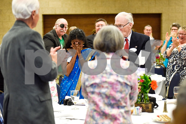 Kui Cogan puts her hands over her face in reaction to people standing and clapping for her while she is honored during the Women in Tyler Luncheon at the Tyler Rose Garden Center in Tyler, Texas, on Thursday, March 23, 2017. The Women in Tyler Planning Committee honored six women who have made an impact in the community. (Chelsea Purgahn/Tyler Morning Telegraph)