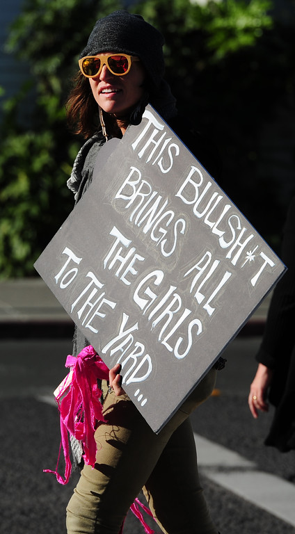 . (CHRIS RILEY �Times-Herald) Sonia Lub of Napa carries her sign as she walks in the Napa Woman\'s March down Third Street on Saturday.
