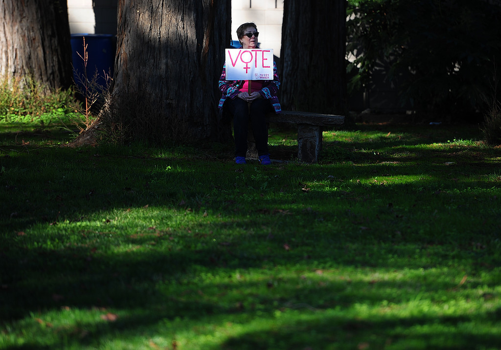 . (CHRIS RILEY �Times-Herald) Elaine Everett of Napa takes a rest in the shade at the women\'s rally in the Napa Valley Expo on Saturday.