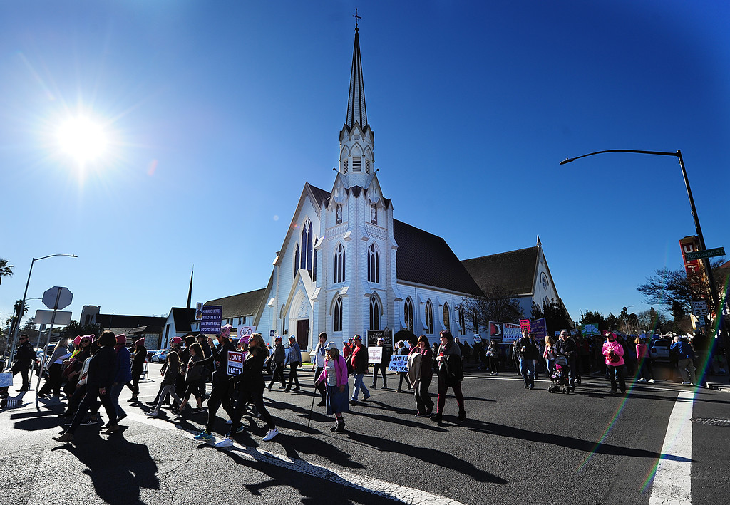 . (CHRIS RILEY �Times-Herald) Marchers walk past the First Presbyterian Church during the Napa Woman\'s March on Saturday.