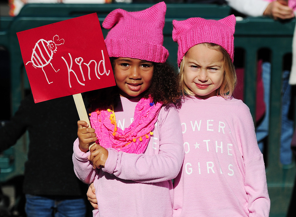 . (CHRIS RILEY �Times-Herald) Best friends, Malika Kalulu and Paige Jackson, 5, show their support for kindness during the women\'s rally in the Napa Valley Expo on Saturday.