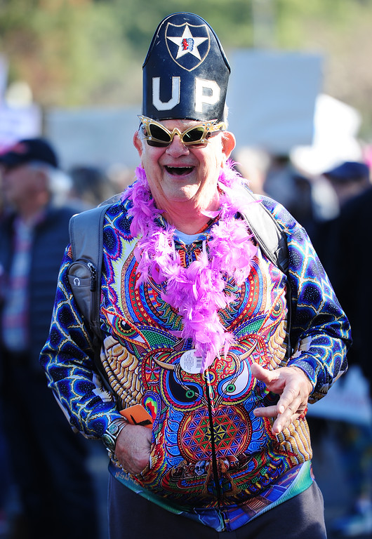 . (CHRIS RILEY �Times-Herald) Scott Clark, of Fairfield, jokes with other marchers at the women\'s rally in the Napa Valley Expo on Saturday.