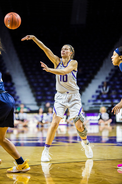Senior guard Kayla Goth passes the ball during K-State's women's basketball game against WVU in Bramlage Coliseum on Feb. 27, 2019. The Wildcats took the Mountaineers 90-79. (Logan Wassall | Collegian Media Group)