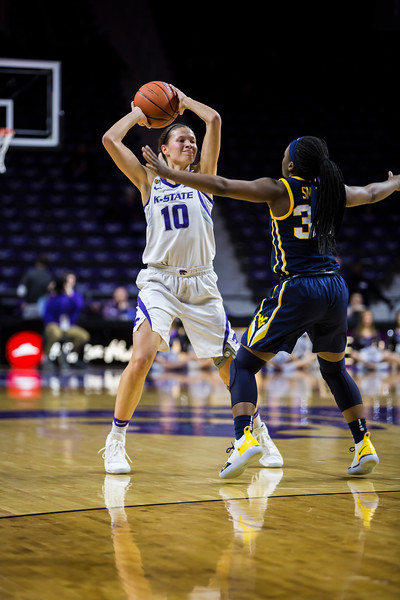 Senior guard Kayla Goth scans the court for an open play during K-State's women's basketball game against WVU in Bramlage Coliseum on Feb. 27, 2019. The Wildcats took the Mountaineers 90-79. (Logan Wassall | Collegian Media Group)