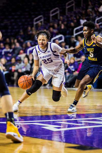 Junior forward Jasauen Beard charges the basket during K-State's women's basketball game against WVU in Bramlage Coliseum on Feb. 27, 2019. The Wildcats took the Mountaineers 90-79. (Logan Wassall | Collegian Media Group)