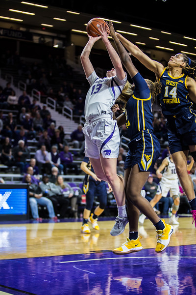 Freshman forward Laura Macke gets fould as she charges the basket during K-State's women's basketball game against WVU in Bramlage Coliseum on Feb. 27, 2019. The Wildcats took the Mountaineers 90-79. (Logan Wassall | Collegian Media Group)
