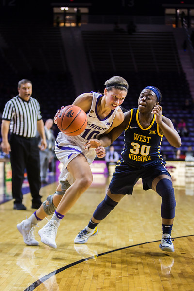 Senior guard Kayla Goth charges the basket during K-State's women's basketball game against WVU in Bramlage Coliseum on Feb. 27, 2019. The Wildcats took the Mountaineers 90-79. (Logan Wassall | Collegian Media Group)