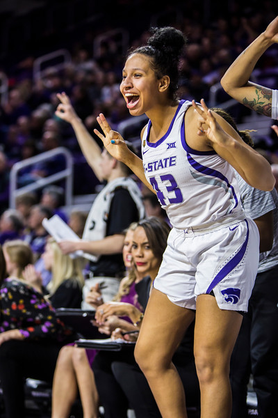Freshman guard Christinna Carr celebrates from the bench after a play during K-State's women's basketball game against WVU in Bramlage Coliseum on Feb. 27, 2019. The Wildcats took the Mountaineers 90-79. (Logan Wassall | Collegian Media Group)