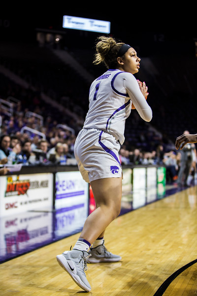 Freshman guard Savannah Simmons scans the court for an open play during K-State's women's basketball game against WVU in Bramlage Coliseum on Feb. 27, 2019. The Wildcats took the Mountaineers 90-79. (Logan Wassall | Collegian Media Group)