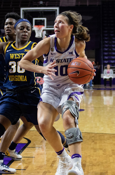 Senior guard, Kayla Goth, rushes towards the basket during the K-State versus West Virginia game on Feb. 27 at Bramlage Coliseum. The Wildcats defeated the Mountaineers 90-79. (Brooke Barrett | Collegian Media Group)