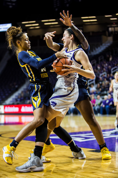 Junior forward Peyton Williams struggles to escape defenders during K-State's women's basketball game against WVU in Bramlage Coliseum on Feb. 27, 2019. The Wildcats took the Mountaineers 90-79. (Logan Wassall | Collegian Media Group)
