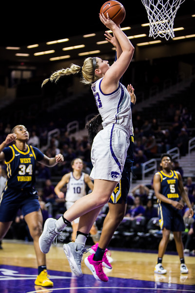 Sophomore center Ashley Ray leaps up for a layup during K-State's women's basketball game against WVU in Bramlage Coliseum on Feb. 27, 2019. The Wildcats took the Mountaineers 90-79. (Logan Wassall | Collegian Media Group)