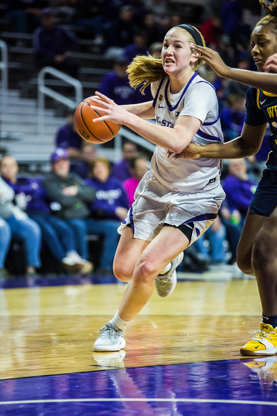 Freshman forward Laura Macke charges the basket during K-State's women's basketball game against WVU in Bramlage Coliseum on Feb. 27, 2019. The Wildcats took the Mountaineers 90-79. (Logan Wassall | Collegian Media Group)