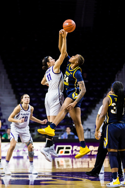 Junior forward Peyton Williams leaps up for the tipoff during K-State's women's basketball game against WVU in Bramlage Coliseum on Feb. 27, 2019. The Wildcats took the Mountaineers 90-79. (Logan Wassall | Collegian Media Group)