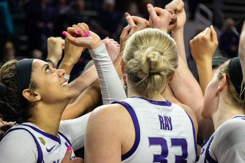 The women's basketball team celebrates their win moments after the final buzzer went off at the K-State versus West Virginia game on Feb. 27.  The Wildcats defeated the Mountaineers 90-79  at Bramlage Coliseum. (Brooke Barrett | Collegian Media Group)