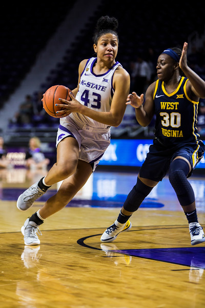 Freshman guard Christinna Carr charges the basket during K-State's women's basketball game against WVU in Bramlage Coliseum on Feb. 27, 2019. The Wildcats took the Mountaineers 90-79. (Logan Wassall | Collegian Media Group)