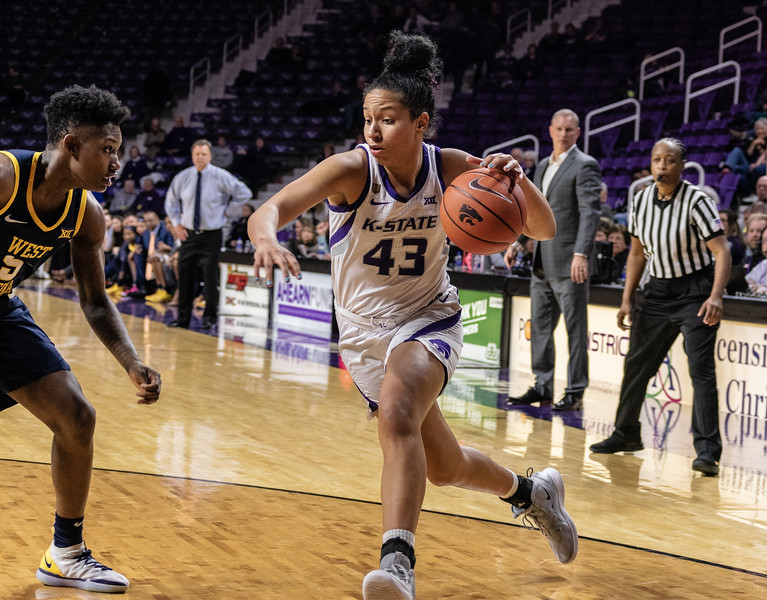 Freshman guard,  Christinna Carr, sprints toward the basket at the K-State versus West Virginia game on Feb. 27 at Bramlage Coliseum. The Wildcats defeated the Mountaineers 90-79. (Brooke Barrett | Collegian Media Group)