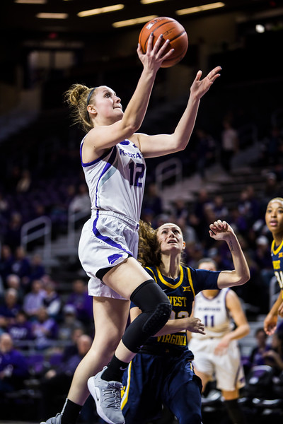Sophomore guard Rachel Ranke leaps up for a shot during K-State's women's basketball game against WVU in Bramlage Coliseum on Feb. 27, 2019. The Wildcats took the Mountaineers 90-79. (Logan Wassall | Collegian Media Group)