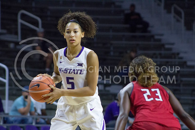 Freshman guard Mercedes Brooks looks for an open teammate at the K-State game against Newman in Bramlage Coliseum on Nov. 7, 2016. (Maddie Domnick | The Collegian)