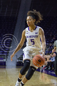 Freshman guard Mercedes Brooks dribbles the ball at the K-State game against Newman in Bramlage Coliseum on Nov. 7, 2016. (Maddie Domnick | The Collegian)
