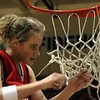 For the Enterprise/DAN KIELING<br /> Point guard Sara Mosiman cuts down the net following the King's girls basketball team's Northwest District 2A title win over Mount Baker March 4, 2005 at Mount Vernon High School.
