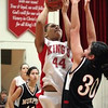 Enterprise/CHRIS GOODENOW<br /> King's Bianca Rowland (44, left) shoots for a basket over Archbishop Murphy's Rachel Shober (30) during their girls basketball game, Wednesday, Dec. 20, 2006 at King's High School. Looking on is King's Laura Friar (20, far left) and Archbishop Murphy's Emma Nelson (11).