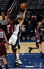 WSU's Ebonee Coates tries to stop Oregon's Taylor Lilley from making a basket