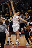 Cal's Devaei Hampton and Stanford's Jayne Appel tip-off