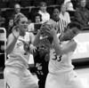 Stanford senior Jillian Harmon rebounds the ball away from Vanguard's Joy Sterling