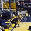The Cal players do some pre game stretches