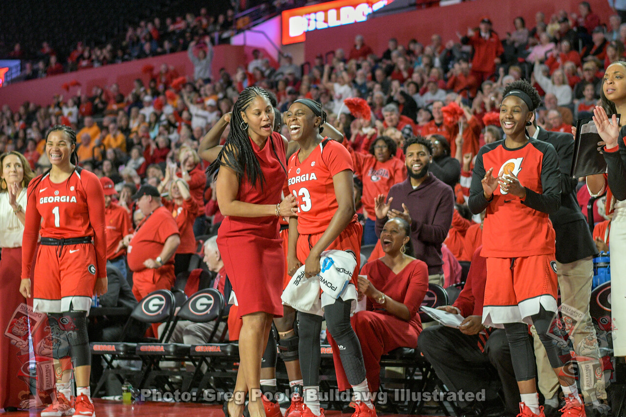Junior Que Morrison (23) with a big smile as she celebrates with her UGA women's basketball teammates and coaches