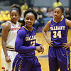 High scorer (23)  Imani Tate allows a smile as Danes near end of 82-71 victory.