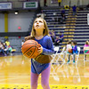 A Girl Scout eyes the hoop during halftime.