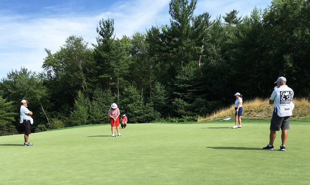 . Tournament winner, the magical Miss Molly Smith, 13, of Westford, gets ready to putt.